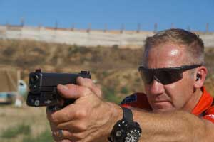 Barry Dueck firing his Glock with a Dueck Defense Fixed Rear Sight DD-DFR-FO25-G